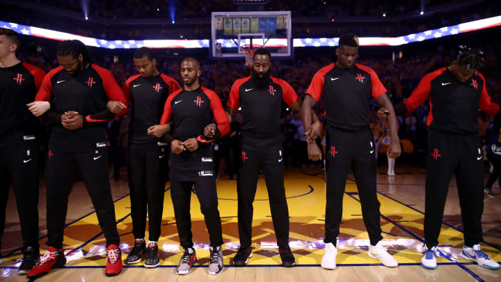 OAKLAND, CALIFORNIA - MAY 08:   The Houston Rockets, includeing Chris Paul #3 and James Harden #13, stand for the National Anthem before their game against the Golden State Warriors in Game Five of the Western Conference Semifinals of the 2019 NBA Playoffs at ORACLE Arena on May 08, 2019 in Oakland, California.  NOTE TO USER: User expressly acknowledges and agrees that, by downloading and or using this photograph, User is consenting to the terms and conditions of the Getty Images License Agreement.  (Photo by Ezra Shaw/Getty Images)
