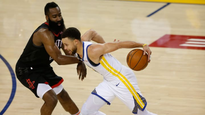 OAKLAND, CALIFORNIA - MAY 08: Stephen Curry #30 of the Golden State Warriors is guarded by James Harden #13 of the Houston Rockets during Game Five of the Western Conference Semifinals of the 2019 NBA Playoffs at ORACLE Arena on May 08, 2019 in Oakland, California. NOTE TO USER: User expressly acknowledges and agrees that, by downloading and or using this photograph, User is consenting to the terms and conditions of the Getty Images License Agreement. (Photo by Lachlan Cunningham/Getty Images)