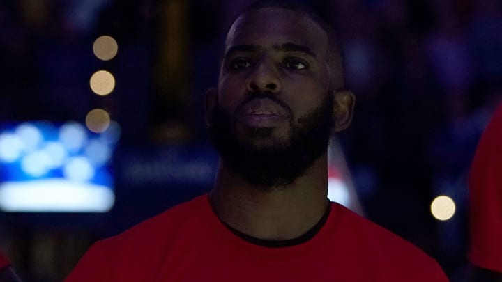 OAKLAND, CA - FEBRUARY 23:  Chris Paul #3 of the Houston Rockets stands for the National Anthem prior to the start of an NBA basketball game against the Golden State Warriors at ORACLE Arena on February 23, 2019 in Oakland, California. NOTE TO USER: User expressly acknowledges and agrees that, by downloading and or using this photograph, User is consenting to the terms and conditions of the Getty Images License Agreement.  (Photo by Thearon W. Henderson/Getty Images)