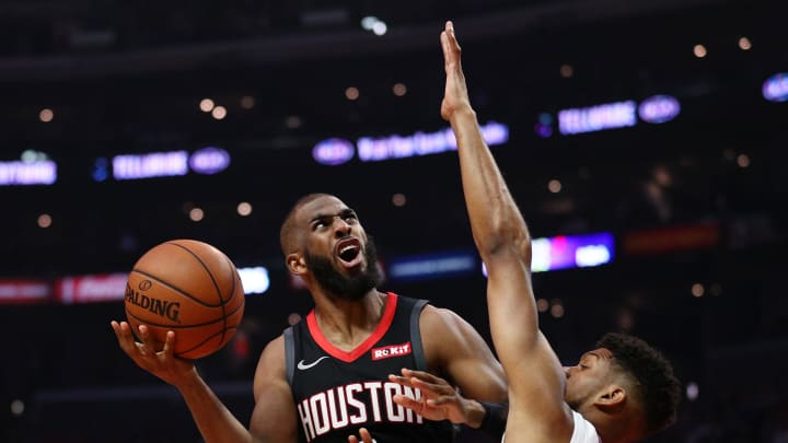 LOS ANGELES, CALIFORNIA - APRIL 03: Chris Paul #3 of the Houston Rockets drives to the basket against Tyrone Wallace #9 of the Los Angeles Clippers during the second half at Staples Center on April 03, 2019 in Los Angeles, California. NOTE TO USER: User expressly acknowledges and agrees that, by downloading and or using this photograph, User is consenting to the terms and conditions of the Getty Images License Agreement. (Photo by Yong Teck Lim/Getty Images)