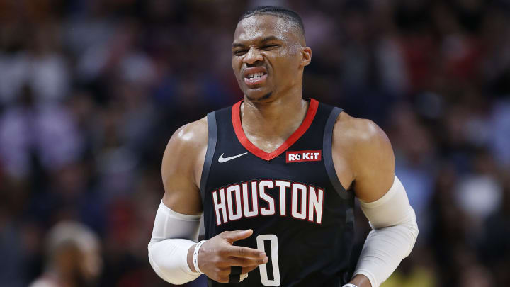 MIAMI, FLORIDA - OCTOBER 18: Russell Westbrook #0 of the Houston Rockets reacts after being injured against the Miami Heat during the second half at American Airlines Arena on October 18, 2019 in Miami, Florida. NOTE TO USER: User expressly acknowledges and agrees that, by downloading and or using this photograph, User is consenting to the terms and conditions of the Getty Images License Agreement. (Photo by Michael Reaves/Getty Images)