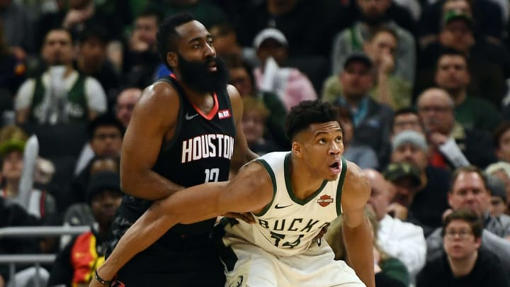 MILWAUKEE, WISCONSIN - MARCH 26:  Giannis Antetokounmpo #34 of the Milwaukee Bucks works against James Harden #13 of the Houston Rockets during a game at Fiserv Forum on March 26, 2019 in Milwaukee, Wisconsin. NOTE TO USER: User expressly acknowledges and agrees that, by downloading and or using this photograph, User is consenting to the terms and conditions of the Getty Images License Agreement. (Photo by Stacy Revere/Getty Images)