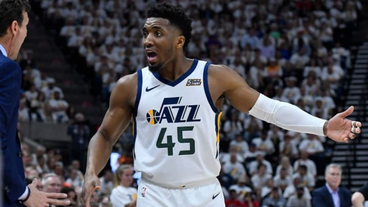 SALT LAKE CITY, UT - APRIL 22: Utah Jazz head coach Quin Synder and Donovan Mitchell #45 of the Utah Jazz interact in the second half of Game Four during the first round of the 2019 NBA Western Conference Playoffs against the Houston Rockets at Vivint Smart Home Arena on April 22, 2019 in Salt Lake City, Utah. NOTE TO USER: User expressly acknowledges and agrees that, by downloading and or using this photograph, User is consenting to the terms and conditions of the Getty Images License Agreement. (Photo by Gene Sweeney Jr./Getty Images)