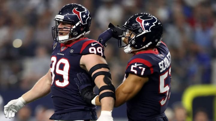 ARLINGTON, TEXAS - AUGUST 24:  J.J. Watt #99 of the Houston Texans celebrates a tackle with Brennan Scarlett #57during a NFL preseason game against the Dallas Cowboys in the first quarter at AT&T Stadium on August 24, 2019 in Arlington, Texas. (Photo by Ronald Martinez/Getty Images)