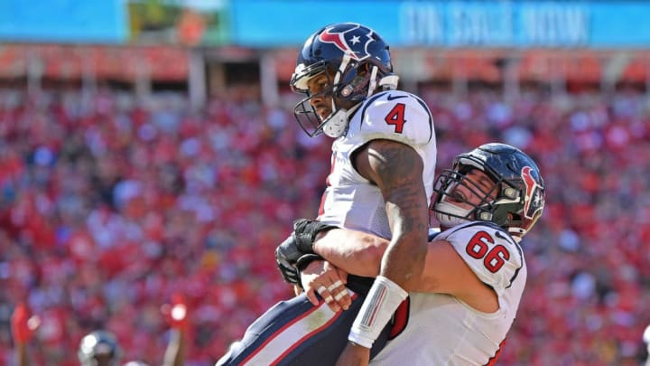 KANSAS CITY, MO - OCTOBER 13:  Quarterback Deshaun Watson #4 of the Houston Texans celebrates after scoring a touchdown with center Nick Martin #66 against the Kansas City Chiefs during the second half at Arrowhead Stadium on October 13, 2019 in Kansas City, Missouri. (Photo by Peter Aiken/Getty Images)