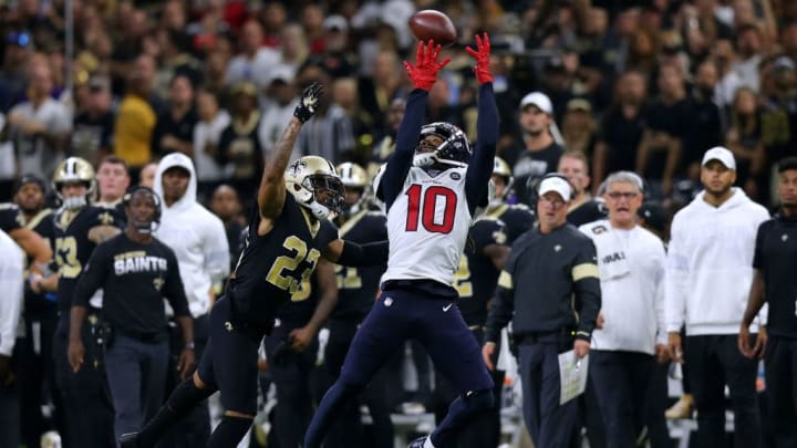 NEW ORLEANS, LOUISIANA - SEPTEMBER 09: DeAndre Hopkins #10 of the Houston Texans catches the ball as Marshon Lattimore #23 of the New Orleans Saints defends during the second half of a game at the Mercedes Benz Superdome on September 09, 2019 in New Orleans, Louisiana. (Photo by Jonathan Bachman/Getty Images)