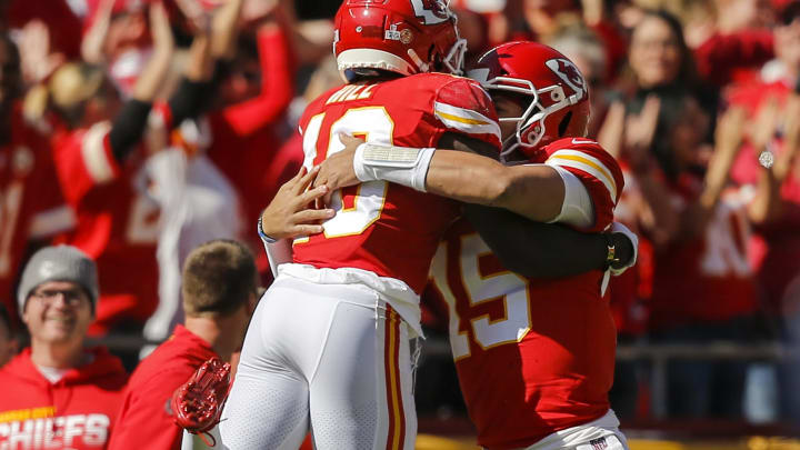 KANSAS CITY, MO - OCTOBER 13: Tyreek Hill #10 of the Kansas City Chiefs leaps in to the arms of Patrick Mahomes #15 of the Kansas City Chiefs after Hill scores on a 46-yard touchdown in the first quarter against the Houston Texans at Arrowhead Stadium on October 13, 2019 in Kansas City, Missouri. (Photo by David Eulitt/Getty Images)