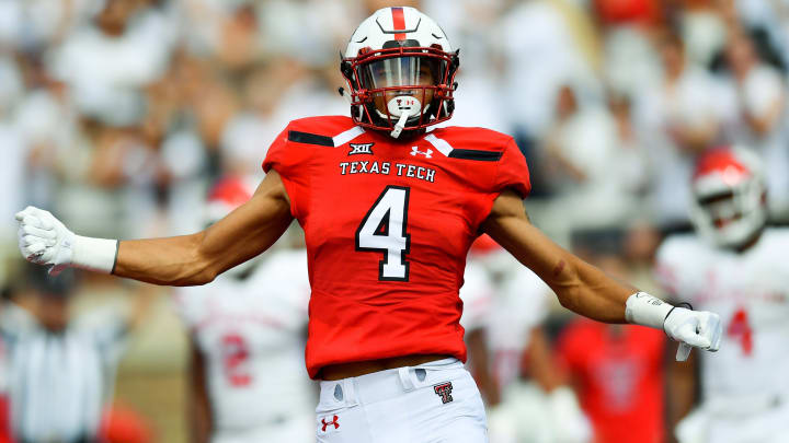 LUBBOCK, TX - SEPTEMBER 15: Antoine Wesley #4 of the Texas Tech Red Raiders celebrates a touchdown during the first half of the game against the Houston Cougars on September 15, 2018 at Jones AT&T Stadium in Lubbock, Texas. (Photo by John Weast/Getty Images)