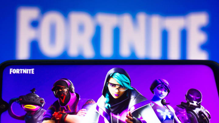 In this photo illustration the Fortnite logo is seen on a...