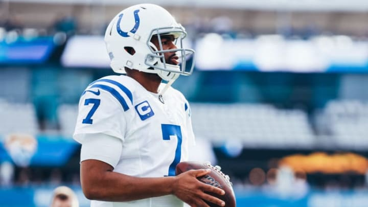 Jacoby Brissett warms up for a game against the Jaguars.