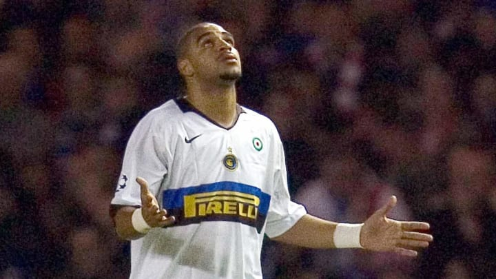 Inter Milan's Adriano (R) looks at the s