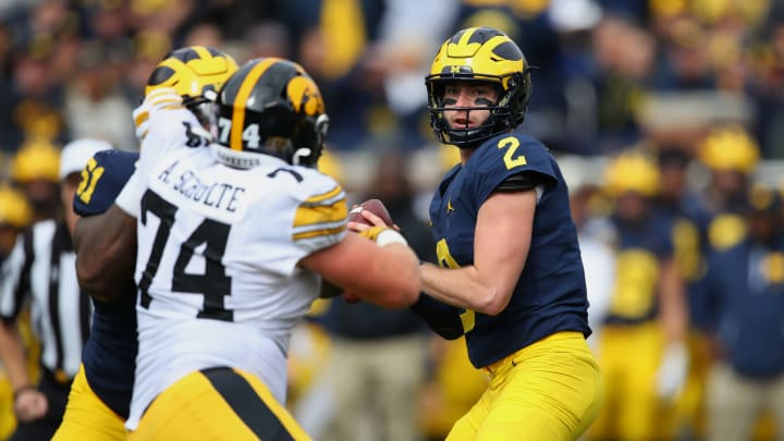 ANN ARBOR, MICHIGAN - OCTOBER 05:  Shea Patterson #2 of the Michigan Wolverines throws a first quarter pass against the Iowa Hawkeyes at Michigan Stadium on October 05, 2019 in Ann Arbor, Michigan. (Photo by Gregory Shamus/Getty Images)
