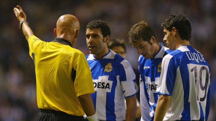 Italian referee Pierluigi Collina argues