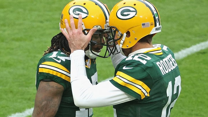 Aaron Rodgers celebrates with Davante Adams.