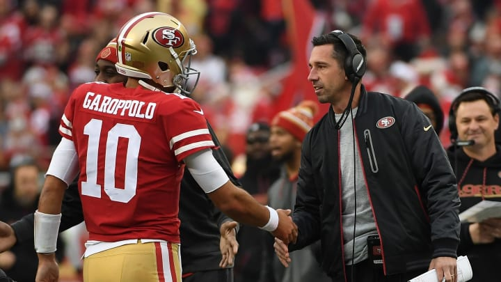 SANTA CLARA, CA - DECEMBER 24:  Head coach Kyle Shanahan of the San Francisco 49ers congratulates Jimmy Garoppolo #10 after a one-yard touchdown run against the Jacksonville Jaguars during their NFL game at Levi's Stadium on December 24, 2017 in Santa Clara, California.  (Photo by Robert Reiners/Getty Images)