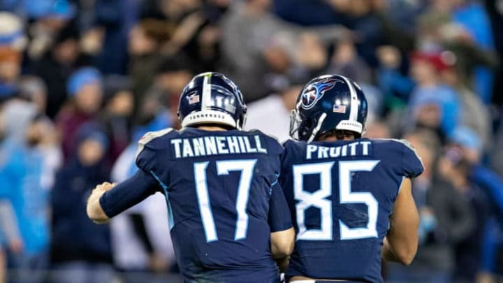 NASHVILLE, TN - NOVEMBER 24:  Ryan Tannehill #17 celebrates after scoring a touchdown with MyCole Pruitt #85 of the Tennessee Titans in the second half of a game against the Jacksonville Jaguars at Nissan Stadium on November 24, 2019 in Nashville, Tennessee.   The Titans defeated the Jaguars 42-20.  (Photo by Wesley Hitt/Getty Images)