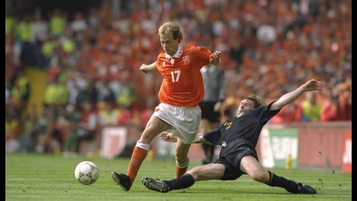 Jordi Cruyff of Holland (left) is tackled by Stewart McKimmie of Scotland