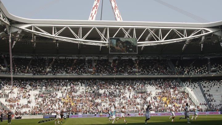 Juventus' players run onto the pitch of