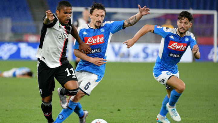 Napoli's Mario Rui competes with Juventus' Douglas Costa for the ball - with Dries Mertens keeping track