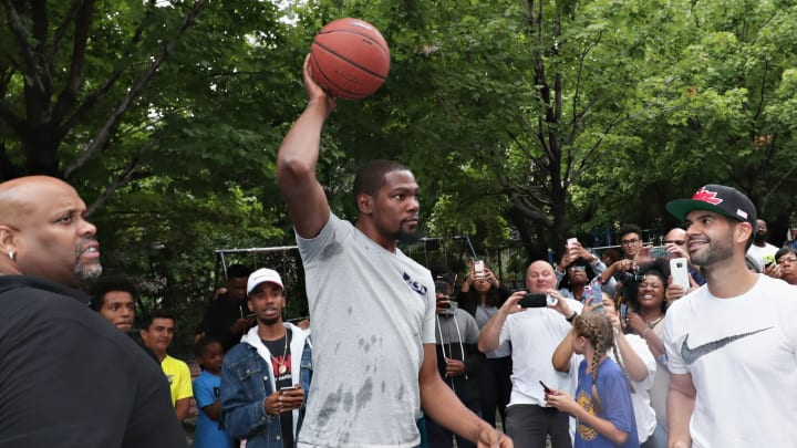 NEW YORK, NY - JULY 24:  Professional basketball player Kevin Durant enters the basketball court during the KD Build It and They Will Ball court ceremony on July 24, 2017 in New York City.  (Photo by Cindy Ord/Getty Images for Kevin Durant Charity Foundation)