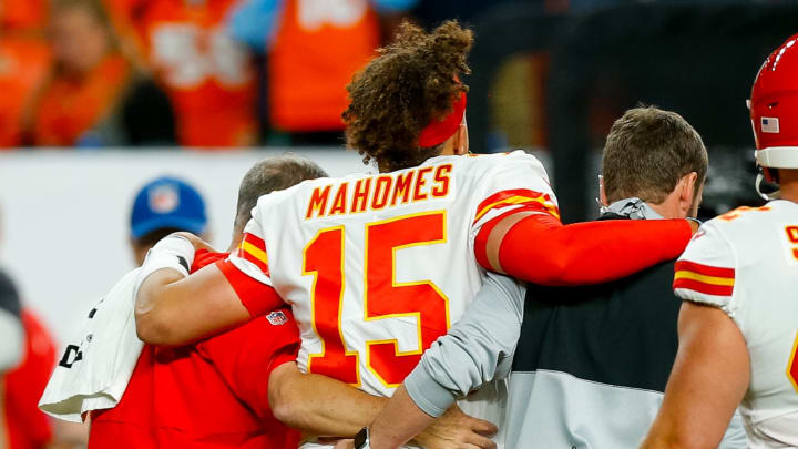 DENVER, CO - OCTOBER 17:  Quarterback Patrick Mahomes #15 of the Kansas City Chiefs is helped off the field after getting injured on a play during the second quarter against the Denver Broncos at Empower Field at Mile High on October 17, 2019 in Denver, Colorado. (Photo by Justin Edmonds/Getty Images)