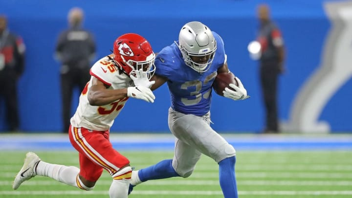 DETROIT, MI - SEPTEMBER 29: Kerryon Johnson #33 of the Detroit Lions runs for a first down as Charvarius Ward #35 of the Kansas City Chiefs makes the stop during the second quarter of the game at Ford Field on September 29, 2019 in Detroit, Michigan. Kansas City defeated Detroit 34-30.  (Photo by Leon Halip/Getty Images)
