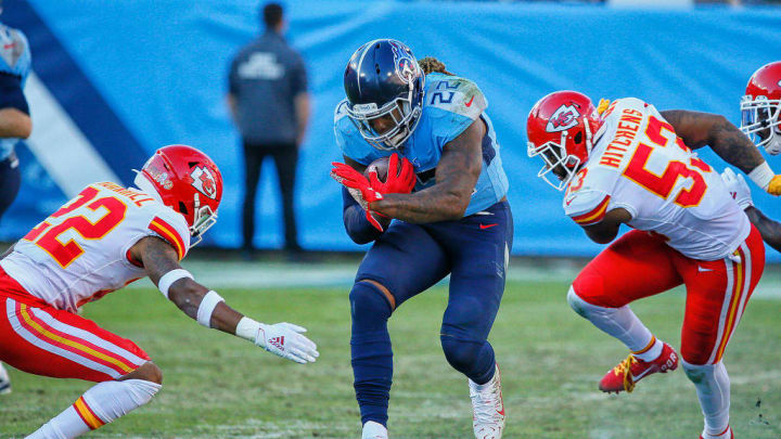 NASHVILLE, TENNESSEE - NOVEMBER 10: Derrick Henry #22 of the Tennessee Titans rushes against Juan Thornhill #22 and Anthony Hitchens #53 of the Kansas City Chiefs during the second half at Nissan Stadium on November 10, 2019 in Nashville, Tennessee. (Photo by Frederick Breedon/Getty Images)