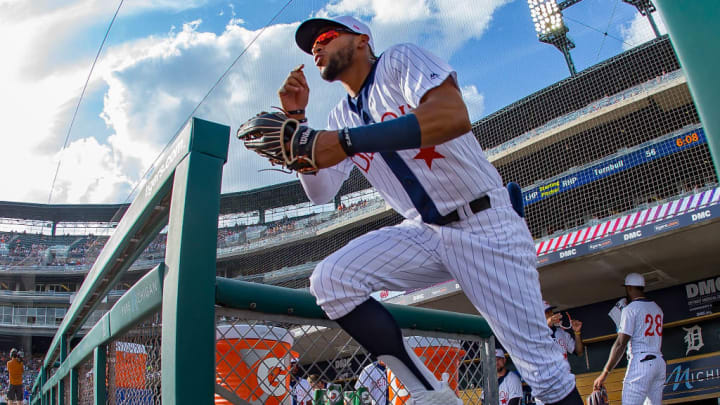 DETROIT, MI - AUGUST 10: Victor Reyes #22 of the Detroit Tigers heads out to the field to start the MLB game against the Kansas City Royals at Comerica Park on August 10, 2019 in Detroit, Michigan. The game tonight is the 25th Annual Commemorative Negro League Game. (Photo by Dave Reginek/Getty Images)