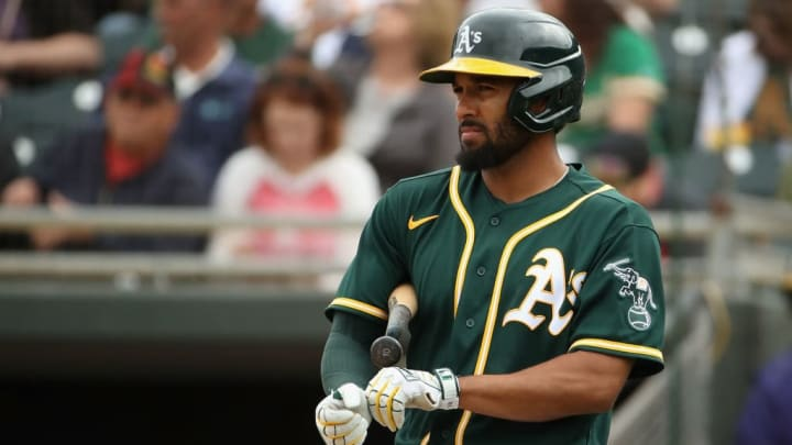 Marcus Semien walks to the plate for the Oakland Athletics