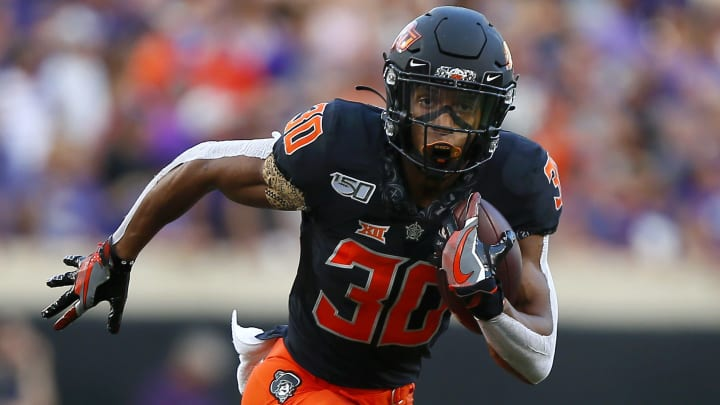 STILLWATER, OK - SEPTEMBER 28:  Running back Chuba Hubbard #30 of the Oklahoma State Cowboys picks up six yards on a touchdown drive against the Kansas State Wildcats in the first quarter on September 28, 2019 at Boone Pickens Stadium in Stillwater, Oklahoma.  Hubbard gained 296 yards as OSU won 26-13.  (Photo by Brian Bahr/Getty Images)