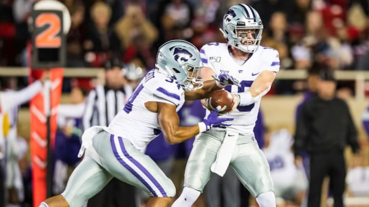 LUBBOCK, TEXAS - NOVEMBER 23: Quarterback Skylar Thompson #10 of the Kansas State Wildcats hands the ball to running back James Gilbert #34 during the first half of the college football game against the Texas Tech Red Raiders on November 23, 2019 at Jones AT&T Stadium in Lubbock, Texas. (Photo by John E. Moore III/Getty Images)