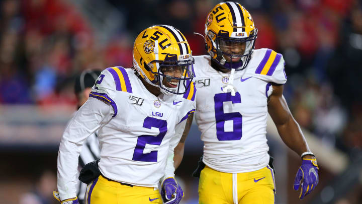 OXFORD, MISSISSIPPI - NOVEMBER 16: Justin Jefferson #2 of the LSU Tigers celebrates a touchdown with Terrace Marshall Jr. #6 during the second half of a game against the Mississippi Rebels at Vaught-Hemingway Stadium on November 16, 2019 in Oxford, Mississippi. (Photo by Jonathan Bachman/Getty Images)