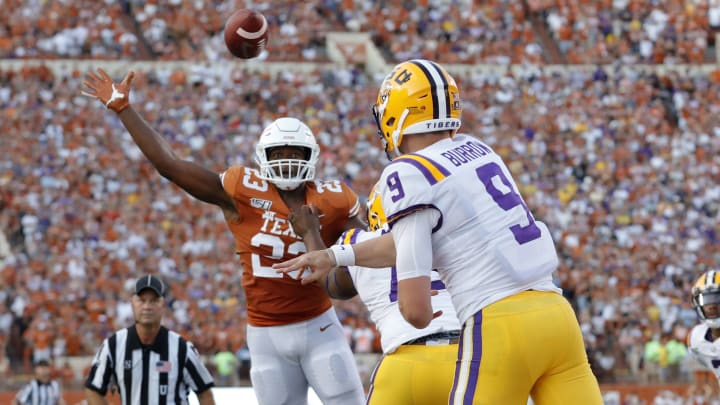 AUSTIN, TX - SEPTEMBER 07:  Jeffrey McCulloch #23 of the Texas Longhorns tips a pass by Joe Burrow #9 of the LSU Tigers in the first quarter at Darrell K Royal-Texas Memorial Stadium on September 7, 2019 in Austin, Texas.  (Photo by Tim Warner/Getty Images)