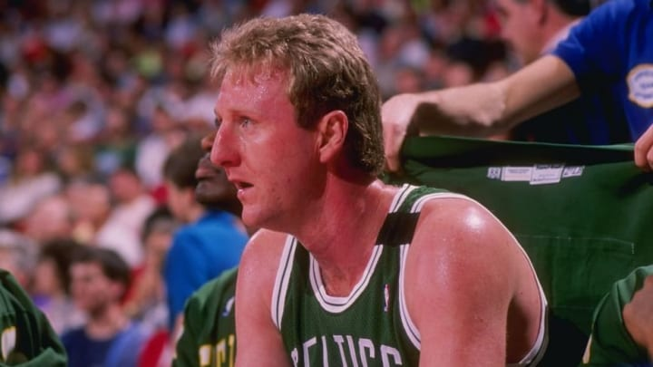 Forward Larry Bird of the Boston Celtics sits on the bench during a game.
