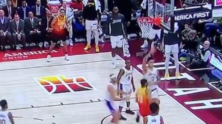 LeBron James walks on the court in socks while celebrating Kyle Kuzma's block against the Jazz