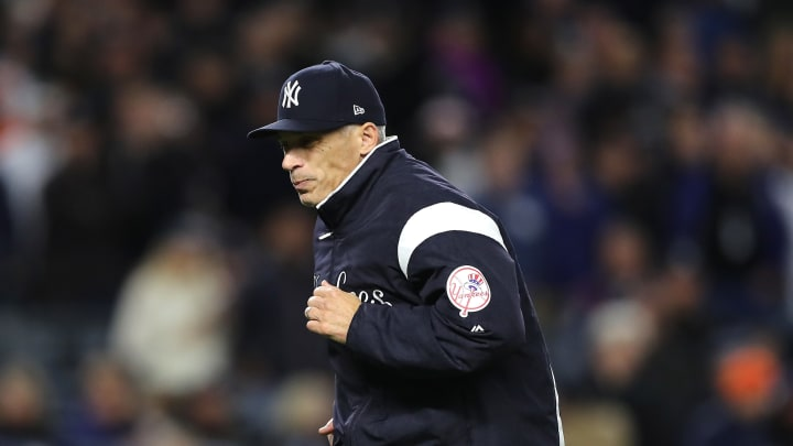 NEW YORK, NY - OCTOBER 16: Manager Joe Girardi #28 of the New York Yankees visits the mound during the sixth inning against the Houston Astros in Game Three of the American League Championship Series at Yankee Stadium on October 16, 2017 in the Bronx borough of New York City.  (Photo by Elsa/Getty Images)