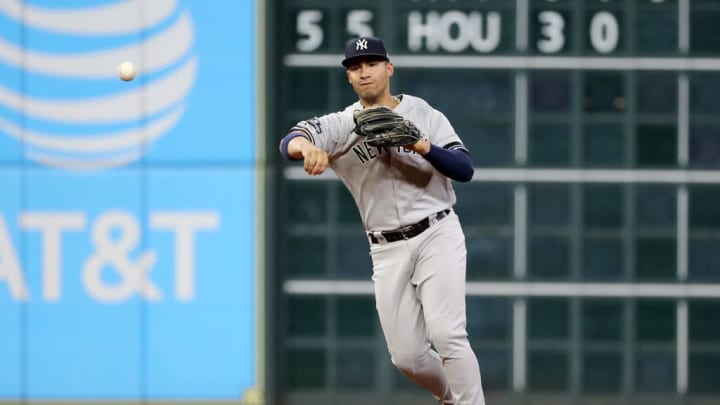 HOUSTON, TEXAS - OCTOBER 19:  Gleyber Torres #25 of the New York Yankees throws out the runner against the New York Yankees during the third inning in game six of the American League Championship Series at Minute Maid Park on October 19, 2019 in Houston, Texas. (Photo by Elsa/Getty Images)