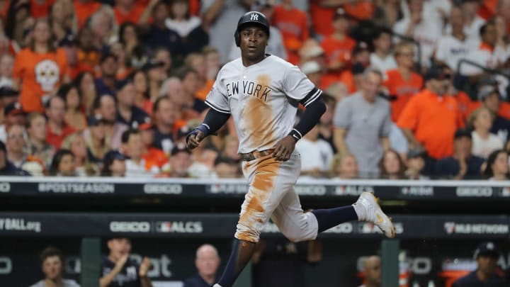 HOUSTON, TEXAS - OCTOBER 19:  Didi Gregorius #18 of the New York Yankees scores a run against the Houston Astros during the second inning in game six of the American League Championship Series at Minute Maid Park on October 19, 2019 in Houston, Texas. (Photo by Elsa/Getty Images)
