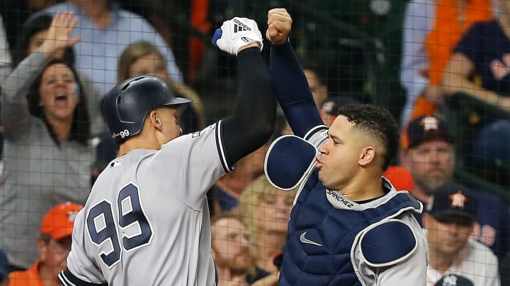 HOUSTON, TEXAS - OCTOBER 13: Aaron Judge #99 of the New York Yankees celebrates with Gary Sanchez #24 after hitting a two-run home run during the fourth inning against the Houston Astros in game two of the American League Championship Series at Minute Maid Park on October 13, 2019 in Houston, Texas. (Photo by Bob Levey/Getty Images)