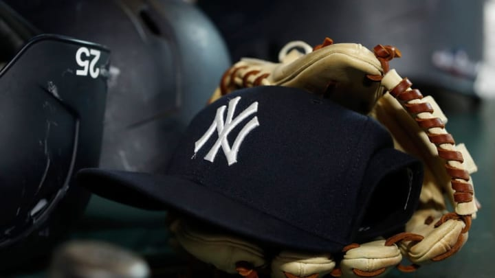 HOUSTON, TX - OCTOBER 19:  A New York Yankees hat and glove are seen in the dugout during Game Six of the League Championship Series at Minute Maid Park on October 19, 2019 in Houston, Texas.  (Photo by Tim Warner/Getty Images)