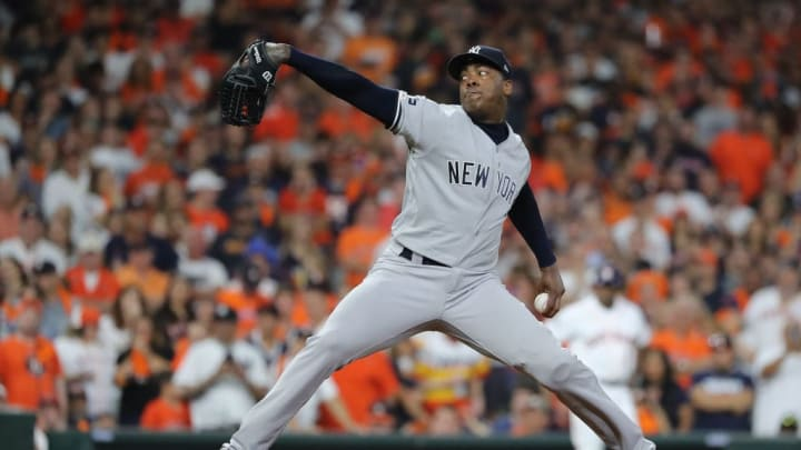 HOUSTON, TEXAS - OCTOBER 19:  Aroldis Chapman #54 of the New York Yankees delivers the pitch against the Houston Astros during the ninth inning in game six of the American League Championship Series at Minute Maid Park on October 19, 2019 in Houston, Texas. (Photo by Elsa/Getty Images)