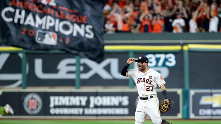HOUSTON, TX - OCTOBER 21:  Jose Altuve #27 of the Houston Astros celebrates after defeating the New York Yankees by a score of 4-0 to win Game Seven of the American League Championship Series at Minute Maid Park on October 21, 2017 in Houston, Texas. The Houston Astros advance to face the Los Angeles Dodgers in the World Series.  (Photo by Elsa/Getty Images)