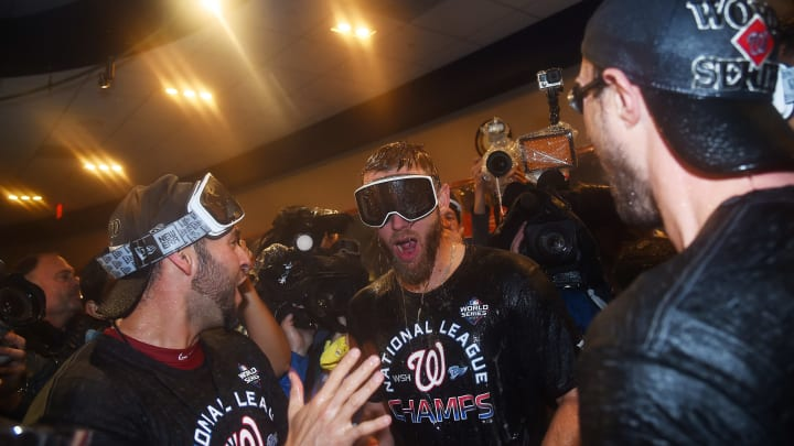 WASHINGTON, DC - OCTOBER 15: Stephen Strasburg #37 of the Washington Nationals celebrates with teammates in the clubhouse after they won game four and the National League Championship Series against the St. Louis Cardinals at Nationals Park on October 15, 2019 in Washington, DC. (Photo by Will Newton/Getty Images)