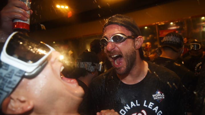 WASHINGTON, DC - OCTOBER 15: Max Scherzer #31 of the Washington Nationals celebrates with teammates in the clubhouse after they won game four and the National League Championship Series against the St. Louis Cardinals at Nationals Park on October 15, 2019 in Washington, DC. (Photo by Will Newton/Getty Images)