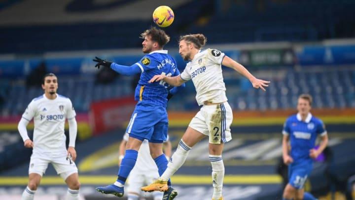 Luke Ayling battling with Alexis Mac Allister