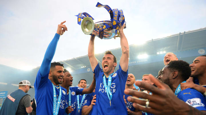 Leicester City player Christian Fuchs lifting the Premier League trophy in 2016