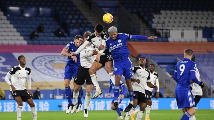 Antonee Robinson goes up with Wesley Fofana