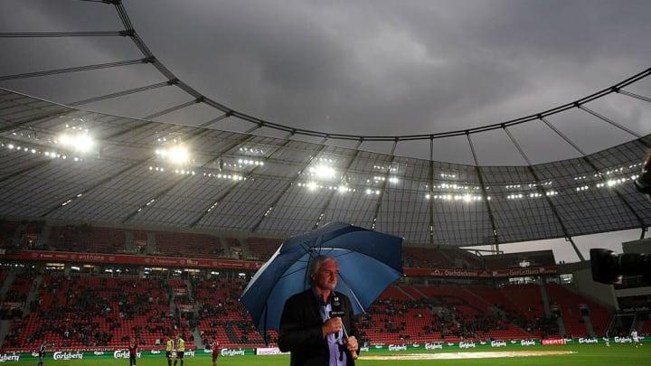Leverkusen's manager Rudi Voeller stands