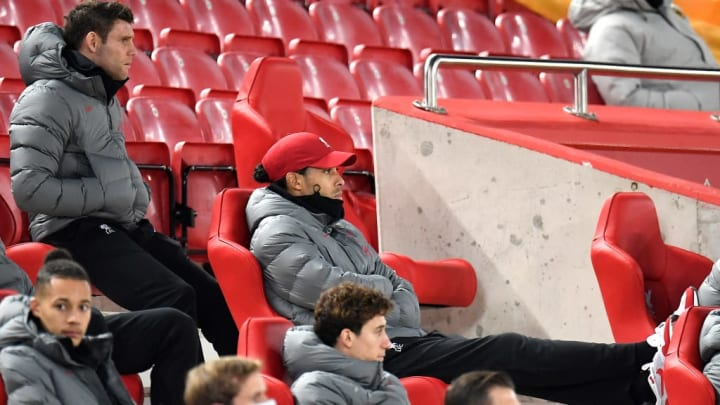 The injured Van Dijk watching on from the stands