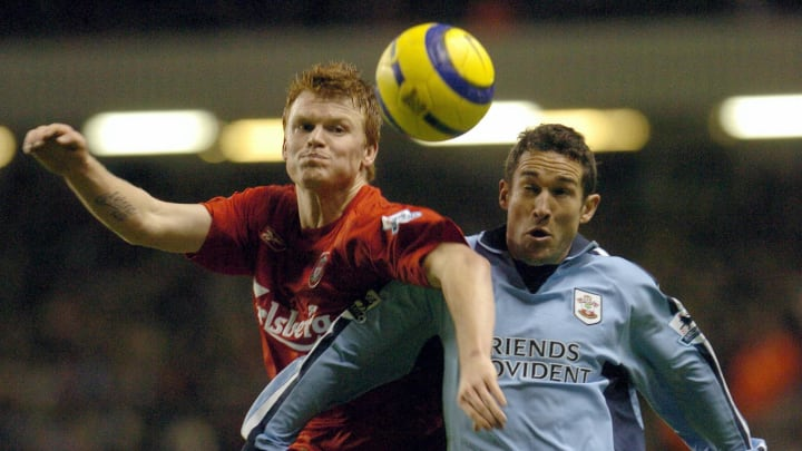 Liverpool's John Arne Riise (L) challeng